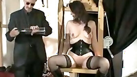 Lovely brunette spanked and fisted BDSM style